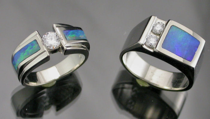 Handcrafted 14K white gold wedding rings with diamonds and opal inlay