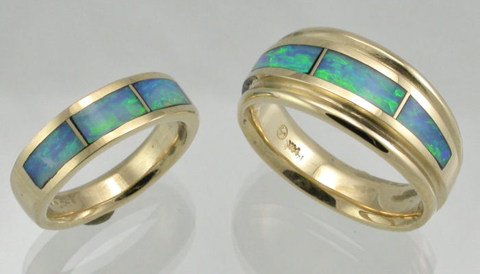 Blue and Green Australian Opal inlaid in 14KT yellow gold wedding bands by James Hardwick.