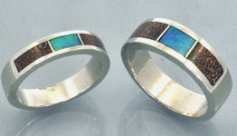Matching wedding bands in sterling silver with dinosaur bone inlay