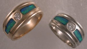Custom made wedding bands in 14KT yellow and 14KT white gold with diamonds and opal.