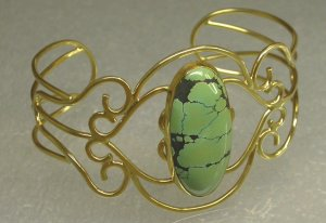 14KT yellow fabricated bracelet with green turquoise cab